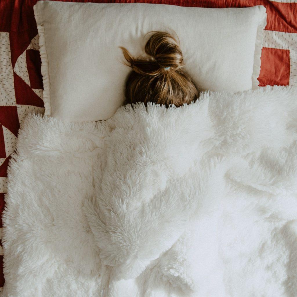 white fur textile on red and white textile